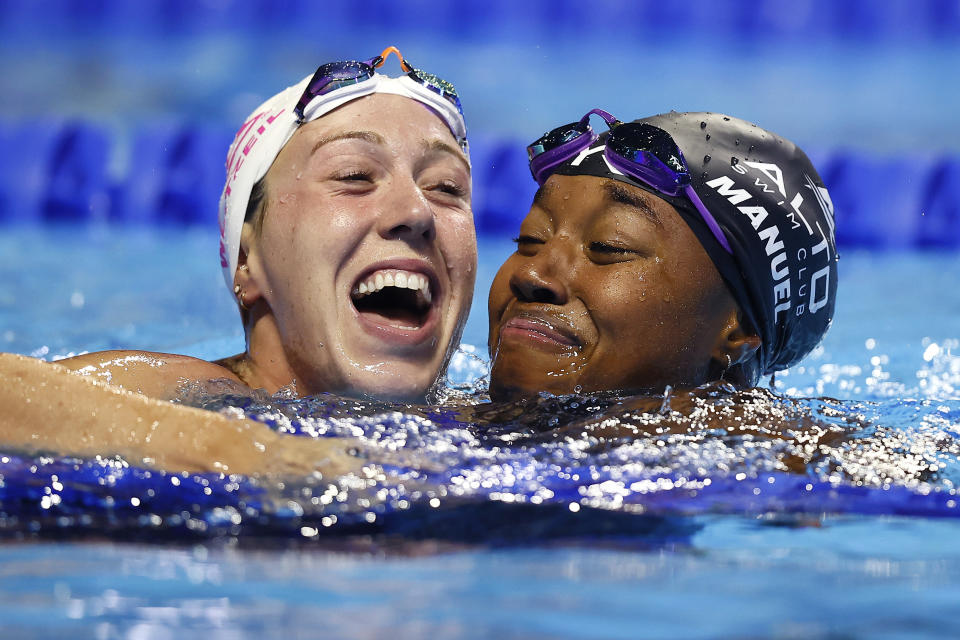 OMAHA, NEBRASKA - JUNE 20: Abbey Weitzeil and Simone Manuel of the United States react after competing in the Women's 50m freestyle final during Day Eight of the 2021 U.S. Olympic Team Swimming Trials at CHI Health Center on June 20, 2021 in Omaha, Nebraska. (Photo by Tom Pennington/Getty Images)