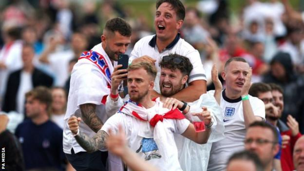 Fans in Manchester react after Manchester United's Harry Maguire scores England's second goal