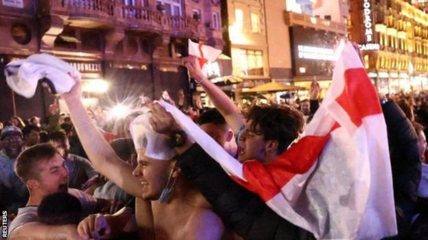 England fans celebrate victory over Ukraine in London's Leicester Square